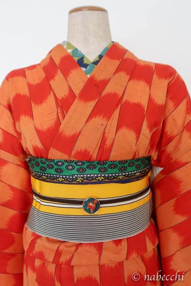 オレンジ矢絣柄ウール着物 × 黄色博多半幅帯